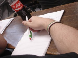 A Jobbik student attends class with pen and bracelet in the colours of the Hungarian flag
