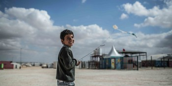 Omar*, 13, from Daraa in Syria, flies a kite in Zaatari refugee camp in Jordan.
