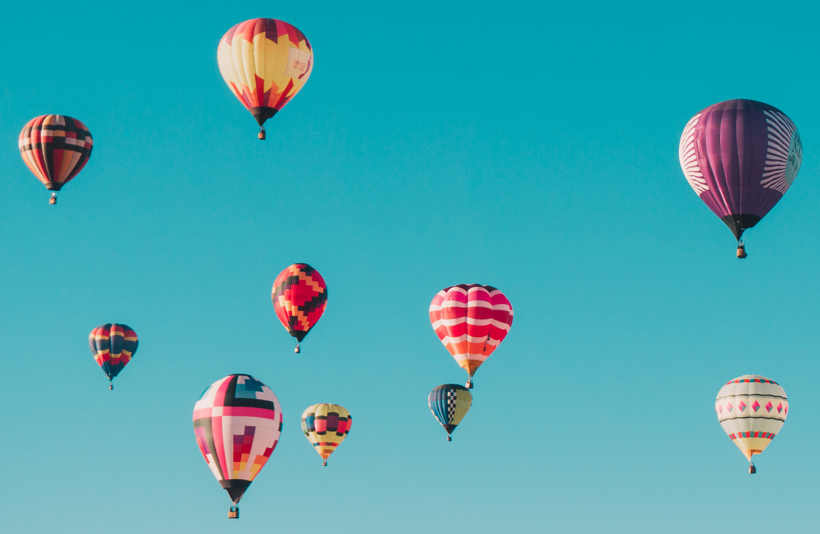 Ten commitments, ten high-flying dreams, symbolised by ten hot-air balloons taking off into the sky.